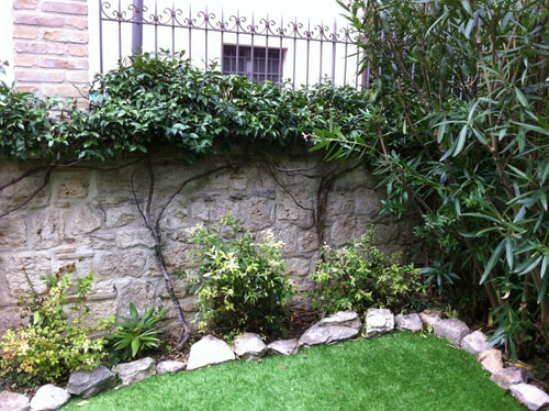 Shrubbery, lawn and ancient wall