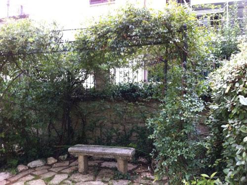 Pergola and stone bench